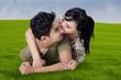 Woman kiss her husband at field