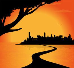 silhouette di città sul fiume