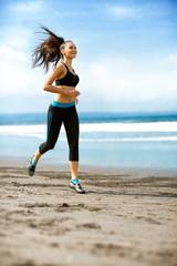 Woman running beach