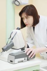 Female doctor optometrist examines eyesight
