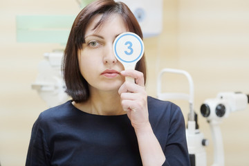 Female patient at a reception at the oculist.