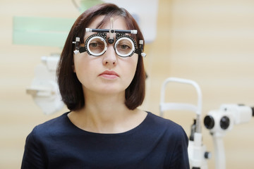 Woman patient in the eye test glasses.