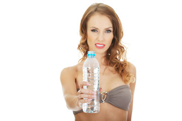 Woman in bra with water.