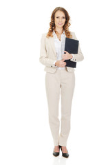 Happy businesswoman with clipboard.
