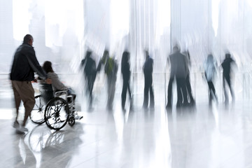 group and disabled people in the lobby business center