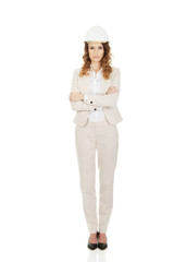 Business woman wearing white helmet.