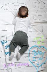 Cute baby boy climbing a wall decoration sketch