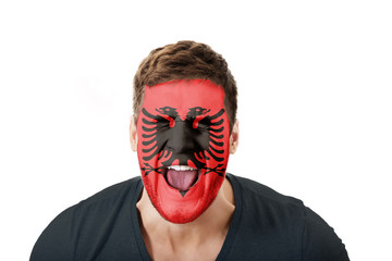 Screaming man with Albania flag on face.