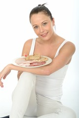 Healthy Happy Young woman Holding a Scandinavian Style Cold Meat