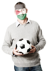 Mature man with Palestine flag on face.