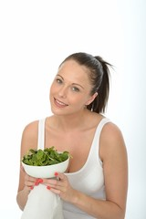 Healthy Young Woman Holding a Bowl of Spinach
