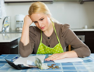 Serious woman calculating family budget