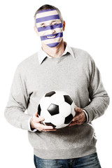 Mature man with Greece flag on face.