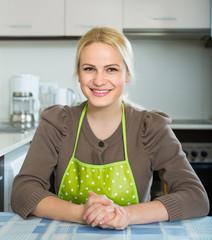 Portrait of woman at kitchen