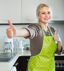 Woman in apron with thumbs up