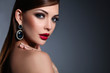 Portrait of beautiful young brunette woman in ear-rings - 81791691