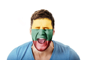 Screaming man with Lithuania flag on face.