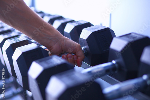 Staande foto Fitness Sports dumbbells in modern sports club