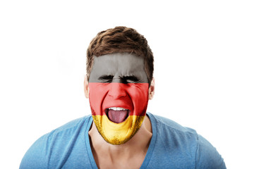 Screaming man with Germany flag on face.