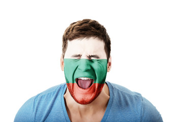 Screaming man with Bulgaria flag on face.