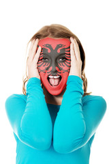 Woman with Albania flag on her face.