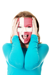 Woman's face painted with flag of Denmark.