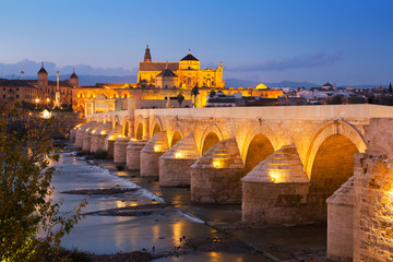 Roman bridge over  river in evening. Cordoba