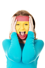 Woman with Spain flag on face.