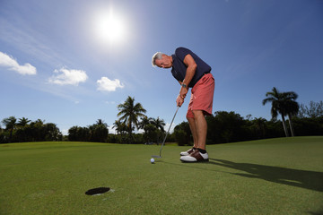 Stock image of a man playing golf