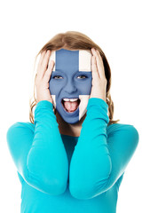 Woman with Finland flag on face.