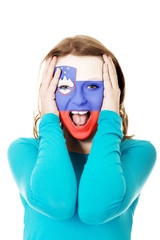 Woman with Slovenia flag on face.