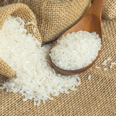Jasmine rice with wooden spoon