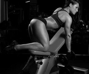 Awesome fitness woman in a gym