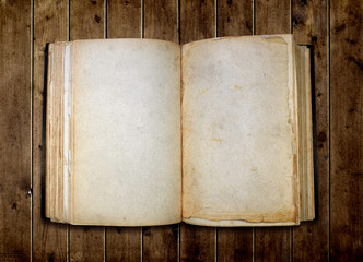 Open old blank book on wooden table