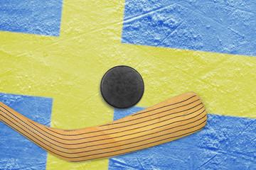 Hockey puck, stick and Swedish flag