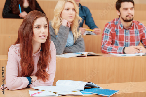 Female student smiles during lecture - 81794413