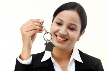 Business woman holding house key
