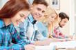 Leinwanddruck Bild - Students at classes
