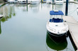 Small motorboat docking at a harbour - 81795851