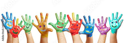 Leinwandbild Motiv Panorama aus vielen bunten Kinderhänden
