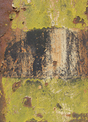 rusty grunge background with yellow paint remains
