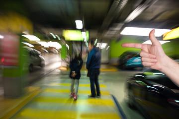Man pointing  in the parking garage