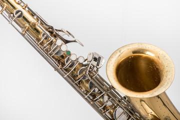 Old saxophone isolatedd  in white background.