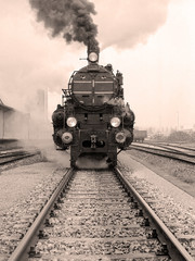 Front view of an old-fashioned steam locomotive