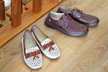 Two pairs of comfortable shoes : for men and for women.