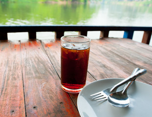 Fresh cola drink on wood table