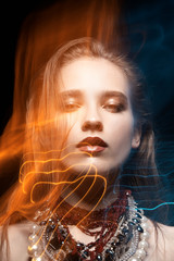 Beautiful girl art portrait with mixed light with accessoryes