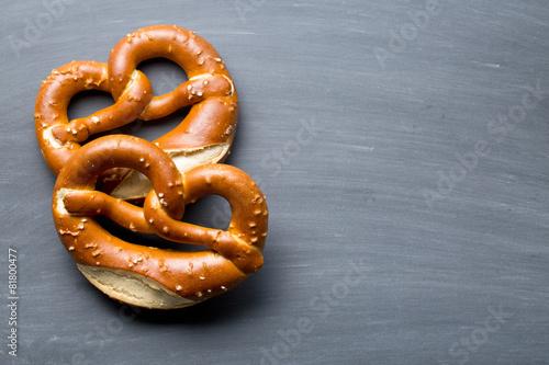 Foto op Canvas Brood baked pretzel on a chalkboard