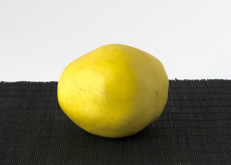 Yellow pomelo on a black and white background