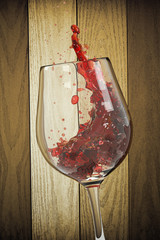 Red Wine Glass and Wooden Background